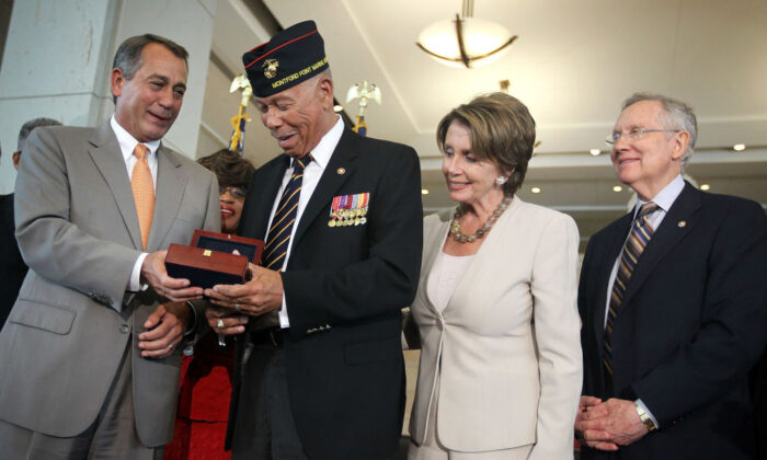 William McDowell (2nd L), a representative of the Montford Point Marines, receives the Congressional Gold Medal from U.S. Speaker of the House Rep. John Boehner (R-OH) (L) as House Minority Leader Rep. Nancy Pelosi (D-CA) (3rd L) and Senate Majority Leader Sen. Harry Reid (D-NV) (4th L) look on during a presentation ceremony at the Emancipation Hall of the Capitol Visitor's Center on Capitol Hill in Washington on June 27, 2012. (Alex Wong/Getty Images)