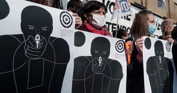 Paper shooting targets are seen during a protest by French police
