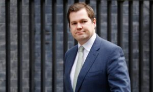 UK Minister Defends Government's Decision to Shelve Short Lockdown Advice