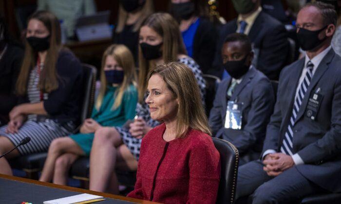 Supreme Court nominee Amy Coney Barrett speaks during a confirmation hearing before the Senate Judiciary Committee on Capitol Hill in Washington, as her family members watch, Oct. 13, 2020. (Shawn Thew/Pool via AP)