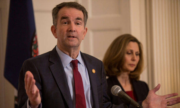 Virginia Gov. Ralph Northam, accompanied by his wife Pamela Northam, announces he will not resign during a news conference in Richmond, Va., on Feb. 2, 2019. (Jay Paul/Reuters)