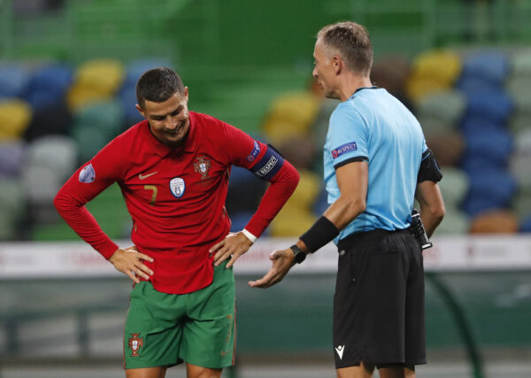 Portugal' s Cristiano Ronaldo, left, reacts when he speaks with referee Paolo Valeri