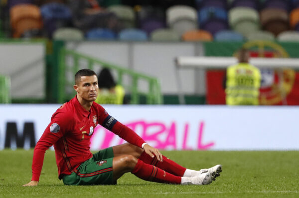 Portugal's Cristiano Ronaldo, right, sits on the pitch during the international friendly soccer match