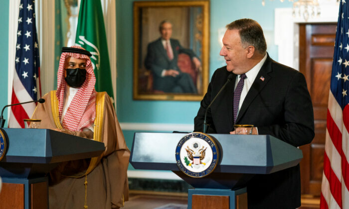 U.S. Secretary of State Mike Pompeo looks at Saudi Minister of Foreign Affairs Prince Faisal bin Farhan Al Saud as he speaks during their meeting at the State Department, in Washington, Oct. 14, 2020. (Manuel Balce Ceneta/Pool via Reuters)