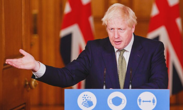 Britain's Prime Minister Boris Johnson gestures as he speaks during a virtual news conference on the ongoing situation with the CCP virus disease (COVID-19), at Downing Street, London, on Oct. 12, 2020. (Toby Melville/Pool via Reuters)