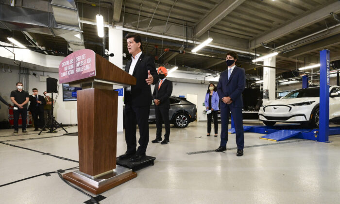 National President of Unifor Jerry Dias speaks as he is joined by Prime Minister Justin Trudeau, Minister of Public Services and Procurement Anita Anand, and Minister of Innovation, Science and Economic Development Navdeep Bains during a press conference at the Ford Connectivity and Innovation Centre in Ottawa, on Oct. 8 2020. (The Canadian Press/Sean Kilpatrick)