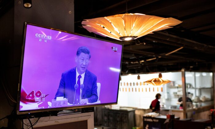 A television screen at a restaurant in Beijing shows Chinese leader Xi Jinping speaking during a broadcast from Shenzhen at an event marking the 40th anniversary of the establishment of the Shenzhen Special Economic Zone on Oct.14, 2020. (Noel Celis/AFP via Getty Images)
