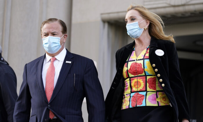 Mark and Patricia McCloskey leave following a court hearing in St. Louis, Mo., on Oct. 14, 2020. (Jeff Roberson/AP Photo)