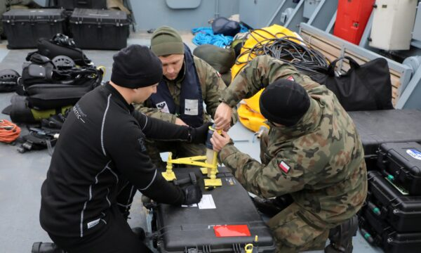 Navy divers take part in an operation to defuse the Tallboy bomb