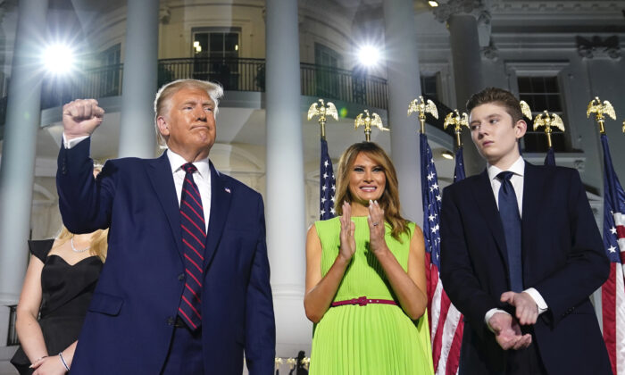 President Donald Trump, First Lady Melania Trump, and Barron Trump stand on the South Lawn of the White House on the fourth day of the Republican National Convention, on Aug. 27, 2020. (Evan Vucci/AP Photo)