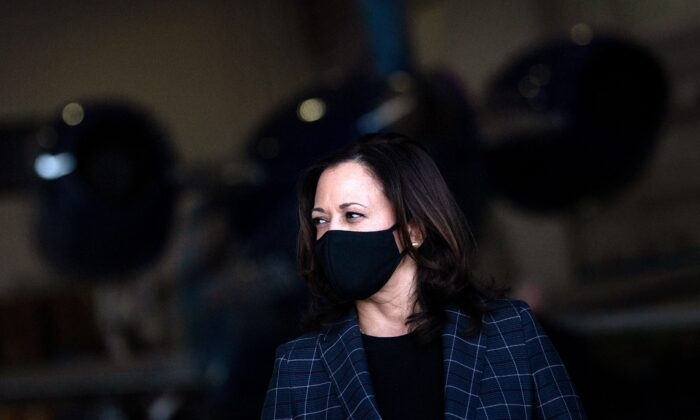 Vice presidential nominee Sen. Kamala Harris (D-Calif.) listens to her running mate speak to reporters at Phoenix Sky Harbor Airport, in Phoenix, Ariz., on Oct. 8, 2020. (Brendan Smialowski/AFP via Getty Images)