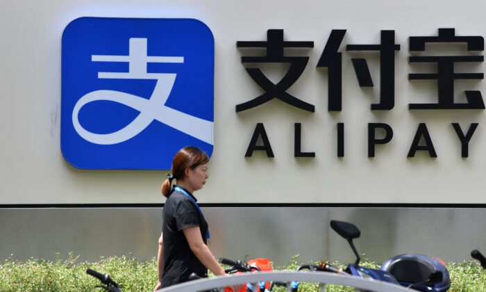 A pedestrian walks past an Alipay logo at the Shanghai office building of Ant Group in Shanghai, on Aug. 28, 2020. (HECTOR RETAMAL/AFP via Getty Images)