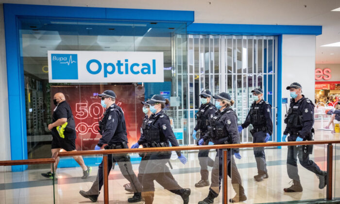 Members of Victoria Police patrol through Chadstone Shopping Centre in Melbourne, Australia on Sept. 20, 2020. (Darrian Traynor/Getty Images)