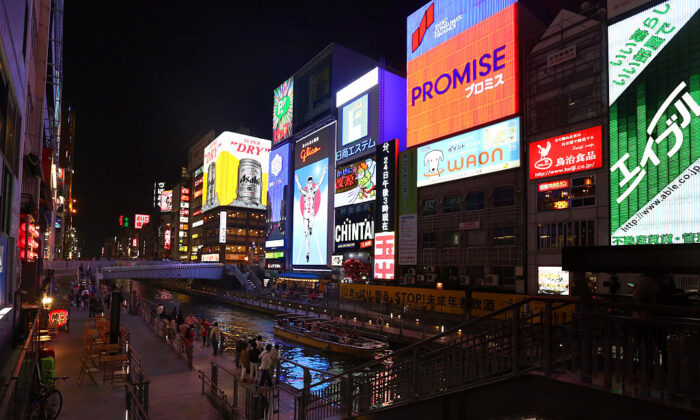 Brightly lit signs advertise businesses in the Dotonbori district of Osaka, Japan, on April 23, 2016. (Carl Court/Getty Images)