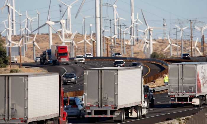 Diesel trucks and cars pass windmills along the 10 freeway near Banning, Calif., on Dec. 8, 2009. (David McNew/Getty Images)