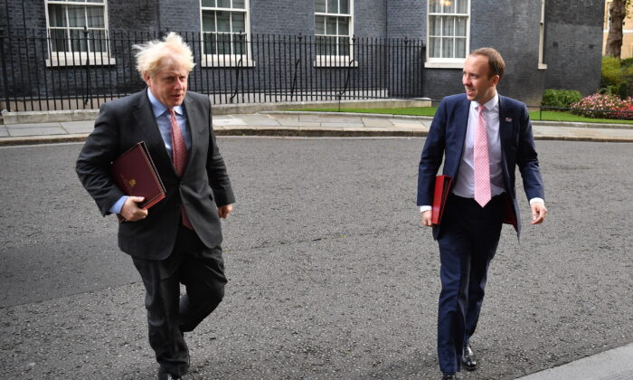 Prime Minister, Boris Johnson and Secretary of State for Health and Social Care, Matt Hancock walk from Downing Street to the Foreign and Commonwealth Office on Sept. 30, 2020. (Leon Neal/Getty Images)