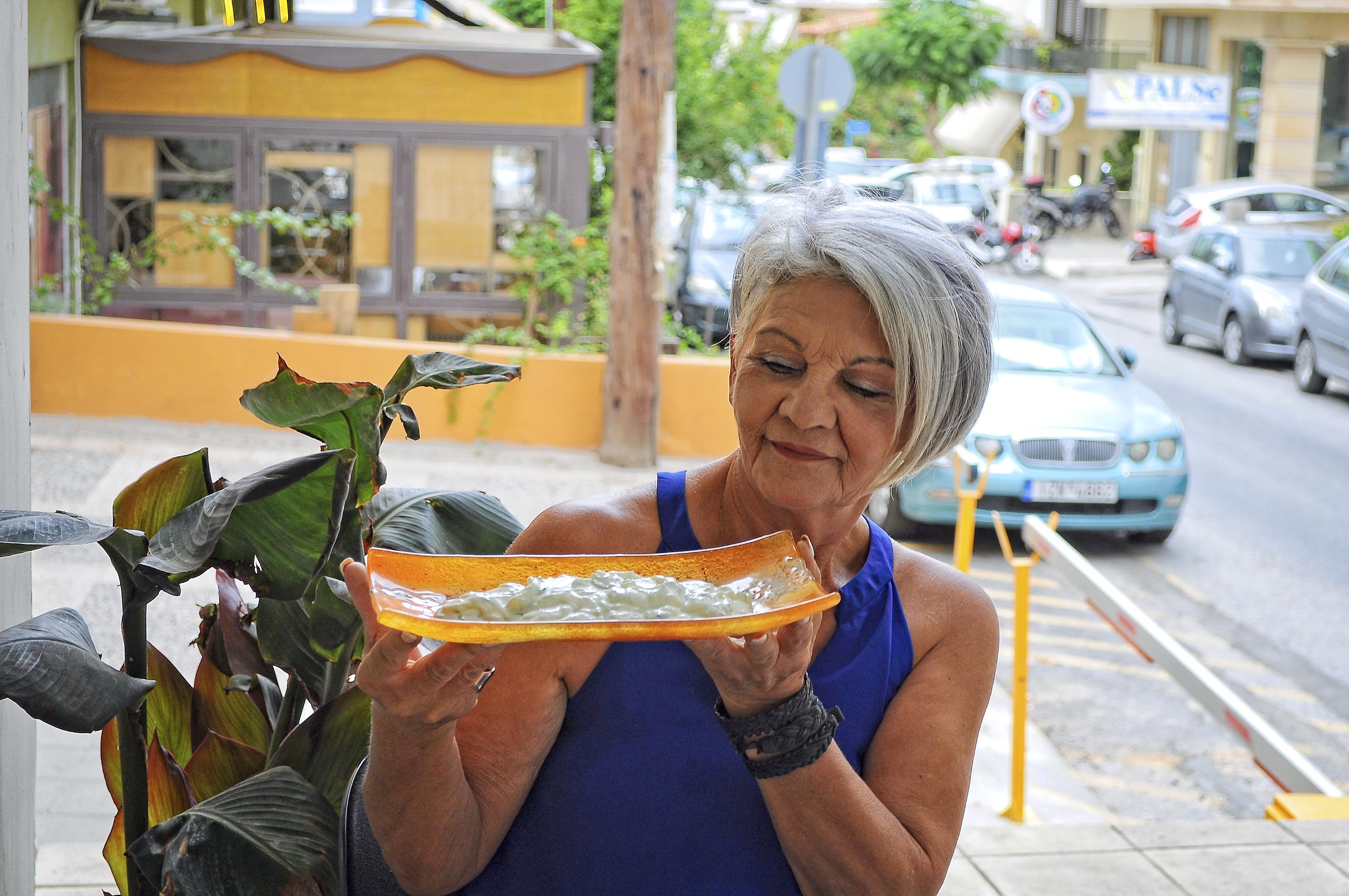 anna louka holding plate of tzatziki