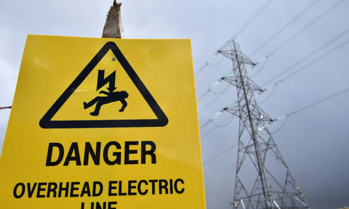 A danger sign sits infront of an electricity pylon in Argyll on March 30, 2016. (Jeff J Mitchell/Getty Images)