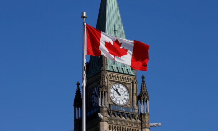 A Canadian flag flies in front of the Peace Tower on Parliament Hill in Ottawa, on March 22, 2017. (Reuters/Chris Wattie/File photo)