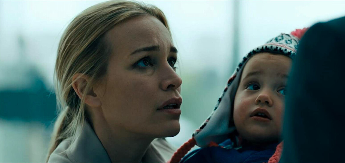"mother holds daughter in ""Angel Has Fallen"""