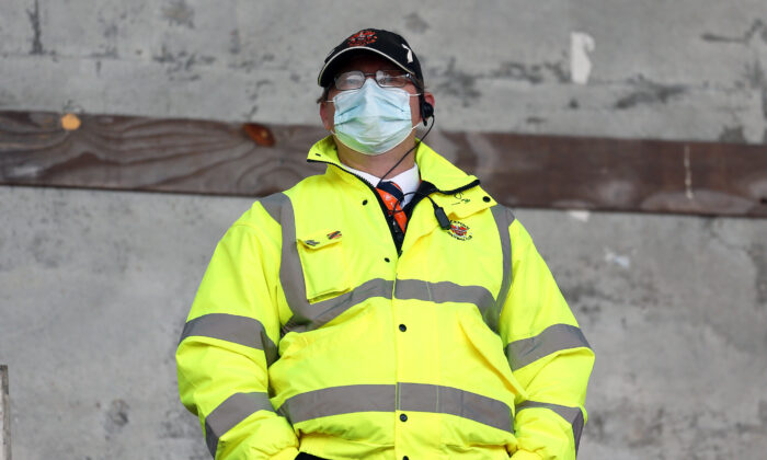 A steward wears a mask at a match between Blackpool and Ipswich Town at Bloomfield Road on Oct. 10, 2020 in Blackpool, England. (Lewis Storey/Getty Images)