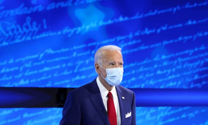 Democratic presidential candidate Joe Biden approaches his seat ahead of an ABC Town Hall event in Philadelphia, Penn., on Oct. 15, 2020. (Tom Brenner/Reuters)
