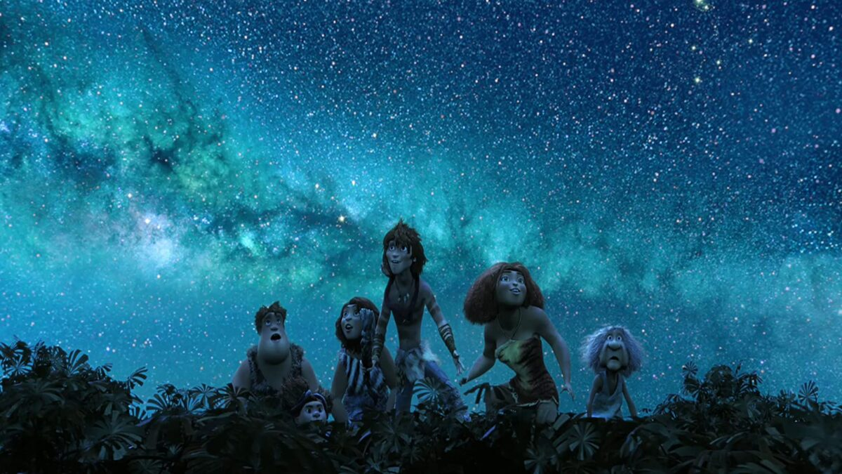 "people standing on treetops looks at the stars in ""The Croods"""