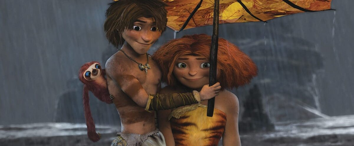 "boy and girl and sloth under an umbrella in ""The Croods"""