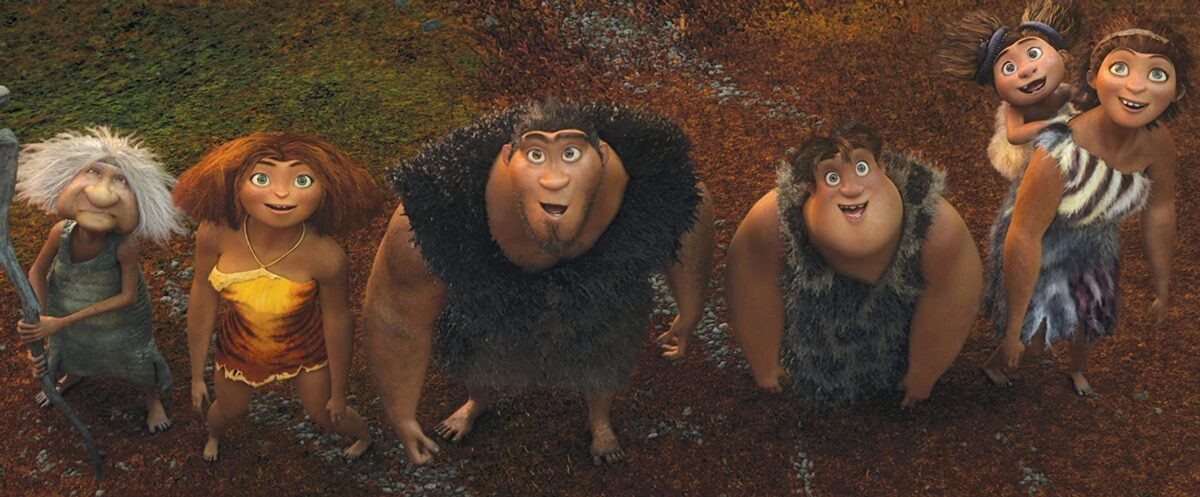 "family of cave people looking upwards in ""The Croods"""