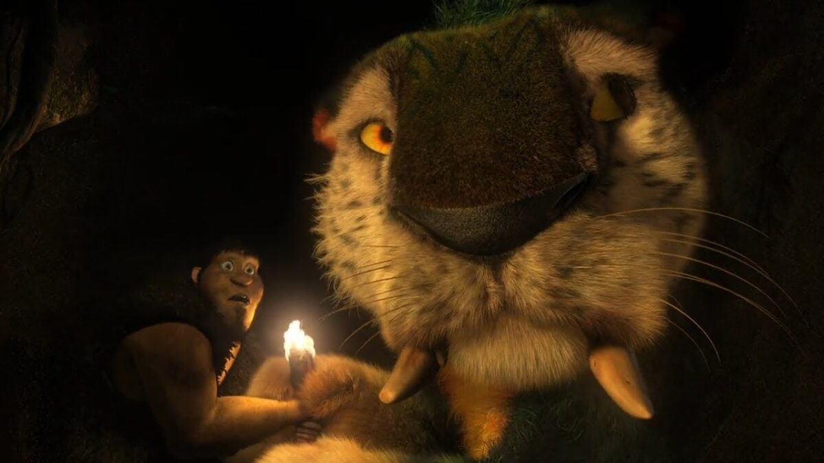 "a caveman and a big cat in ""The Croods"""