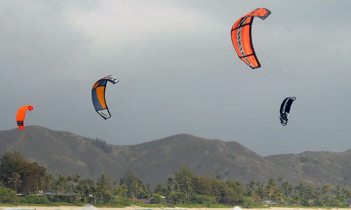 Kite surfers enjoy increasing winds ahead of Hurricane Douglas in the windward town of Kailua on the island of Oahu, Hawaii on July 26, 2020. (Ronen Zilberman/AFP via Getty Images)