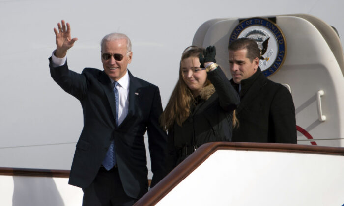 Then Vice President Joe Biden waves as he walks out of Air Force Two with his granddaughter, Finnegan Biden (C) and son Hunter Biden (R) upon their arrival in Beijing on Dec. 4, 2013. (Ng Han Guan/AFP via Getty Images)