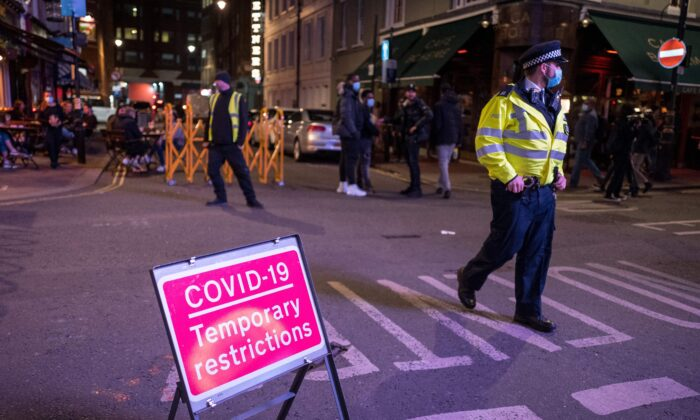 Police patrol in Soho, in central London on Sept. 24, 2020, as the clock nears 10 p.m., on the first day of the new earlier closing times for pubs and bars in England and Wales. (Tolga Akmen/AFP via Getty Images)