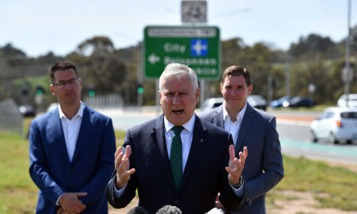 Deputy Prime Minister Michael McCormack (C) speaks to media as Assistant Minister for Finance Zed Seselja (L) and ACT leader of the opposition Alistair Coe look on during a federal road infrastructure announcement on October 05, 2020 in Canberra, Australia. (Sam Mooy/Getty Images)