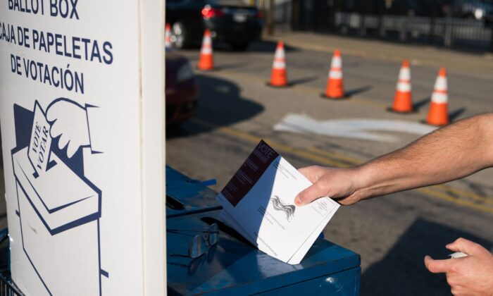 A person collects absentee ballots from voters in Cleveland, Ohio, on Oct. 16, 2020. (Dustin Franz/AFP via Getty Images)