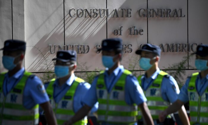 Policemen march in front of the US consulate in Chengdu, southwestern China's Sichuan province, on July 26, 2020. (Noel Celis/AFP via Getty Images)