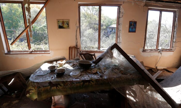 An interior view shows a damaged house following recent shelling in the settlement of Shosh in the course of a military conflict over the breakaway region of Nagorno-Karabakh, on Oct. 17, 2020. (Stringer/Rueters)