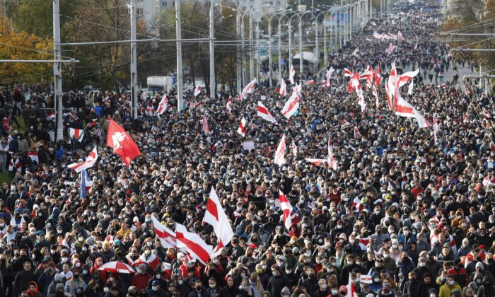 People attend an opposition rally to reject the presidential election results in Minsk, on Oct. 18, 2020. (Stringer/Reuters)