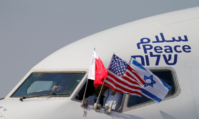 Bahraini, Israeli, and U.S. flags are seen on El Al's airliner carrying an Israeli delegation accompanied by the U.S. treasury secretary as it lands in Muharraq, Bahrain, on Oct. 18, 2020.  (Hamad I Mohammed/Reuters)