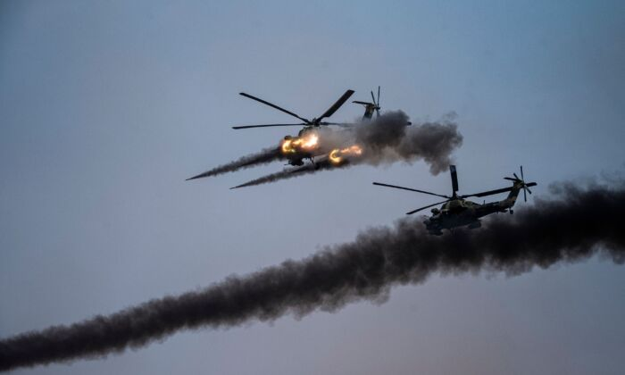 Russian helicopters launch rockets during a join military exercises gathering China, Russia and other countries at the Kapustin Yar range in Astrakhan region, Southern Russia, on Sept. 25, 2020. (DIMITAR DILKOFF/AFP via Getty Images)
