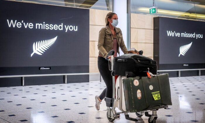 Arrival from New Zealand at Sydney International Airport on Oct. 16, 2020, after Australias border rules were relaxed under a new one-way trans-Tasman travel agreement that allow travellers from New Zealand to visit New South Wales. (David Gray/AFP via Getty Images)