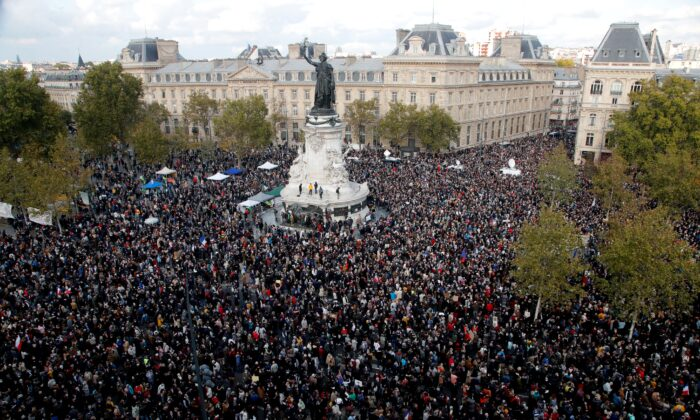 Hundreds of people gather on Republique square during a demonstration in Paris on Oct. 18, 2020. Demonstrations around France have been called in support of freedom of speech and to pay tribute to a French history teacher who was beheaded near Paris after discussing caricatures of Islam's Prophet Muhammad with his class. Samuel Paty was beheaded on Friday by a 18-year-old Moscow-born Chechen refugee who was shot dead by police. (Michel Euler/AP Photo)