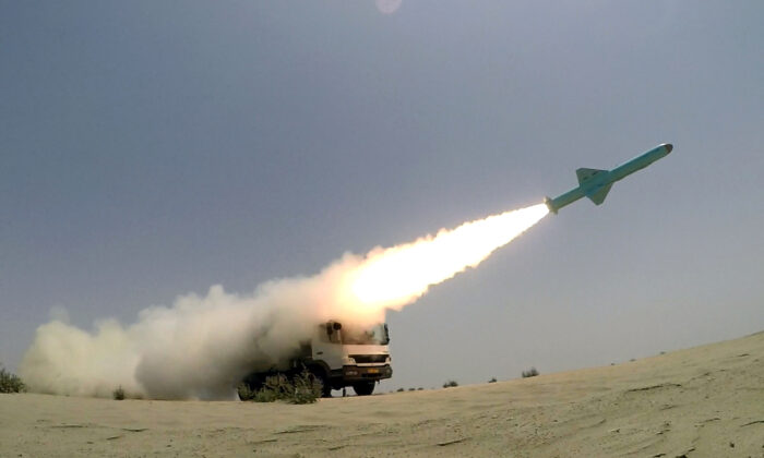 An Iranian locally made cruise missile is fired during war games in the northern Indian Ocean and near the entrance to the Gulf, Iran, on June 17, 2020. (West Asia News Agency via Reuters)