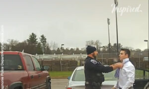 Police officer helps student tie a necktie