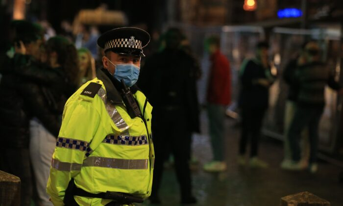 Police patrol as revellers enjoy a night out in the centre of Liverpool, northwest England, on Oct. 10, 2020. (Lindsey Parnaby/AFP via Getty Images)