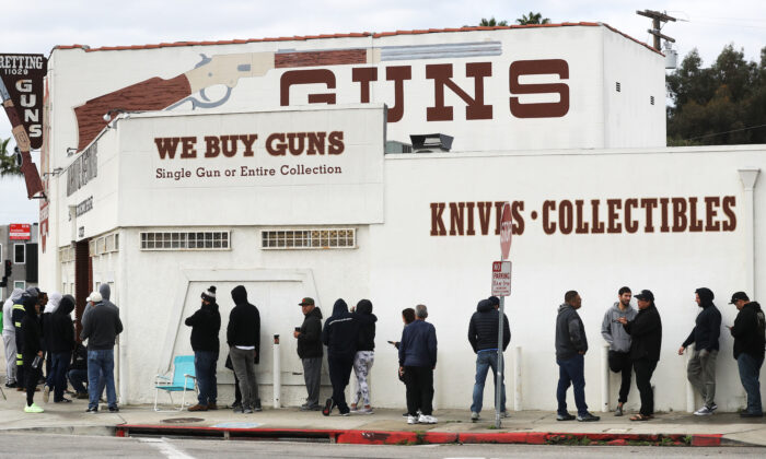 People stand in line outside a gun store in Culver City, Calif., on March 15, 2020. (Mario Tama/Getty Images)