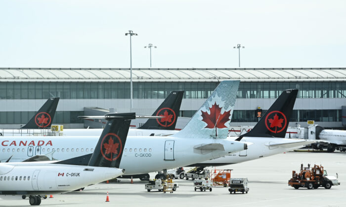 Air Canada planes sit on the tarmac at Pearson International airport during the COVID-19 pandemic in Toronto on Oct. 14, 2020. (The Canadian Press/Nathan Denette)