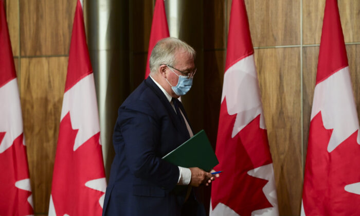 Bill Blair, Minister of Public Safety and Emergency Preparedness, leaves after taking part in a press conference in Ottawa on Monday, Oct. 19, 2020. (THE CANADIAN PRESS/Sean Kilpatrick)