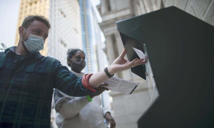 Voters cast their early voting ballot at drop box outside of City Hall in Philadelphia, Pennsylvania, on Oct. 17, 2020. (Mark Makela/Getty Images)
