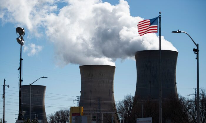 An employee leaves in his car from the nuclear plant on Three Mile Island, with the operational plant run by Exelon Generation on the right, in Middletown, PA, on March 26, 2019. (Andrew Caballero-Reynolds/AFP via Getty Images)